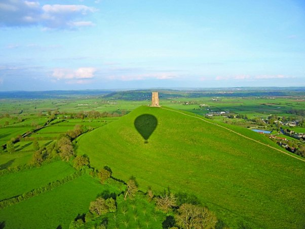 Picture of a hot air balloon shadow over a Tor